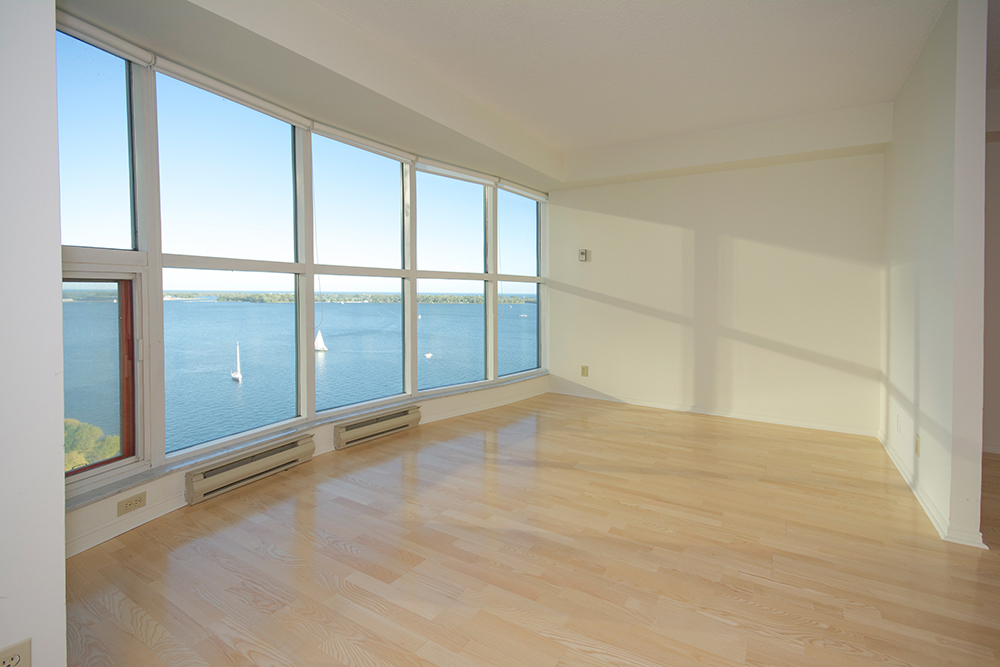 Bright Floor To Ceiling Windows With Laminate Flooring Throughout Facing Spectacular Unobstructed Lake Views