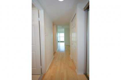 Foyer With Laminate Flooring & Mirrored Closets.