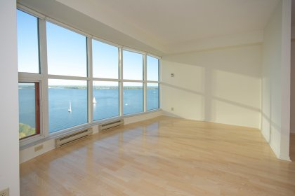 Bright Floor-To-Ceiling Windows With Laminate Flooring Throughout Facing Spectacular Unobstructed Lake Views.