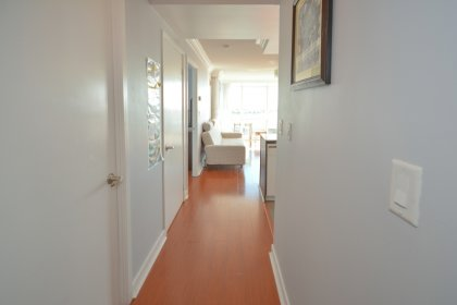 Hallway From Den Area With Laminate Flooring.