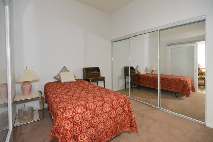 Spacious Sized Master Bedroom With Sliding Doors & Mirrored Closets.