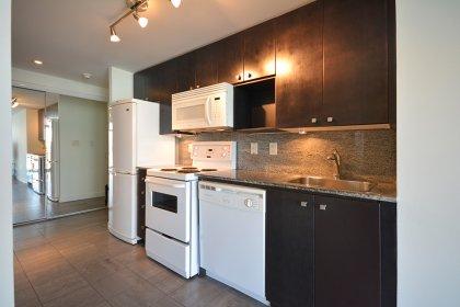 Designer Kitchen Cabinetry With Granite Counter Tops, Granite Backsplash & Undermount Lighting.