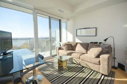 Spacious Sized Bedroom With A Large Closet & Walk-Out Balcony Facing Bright & Stunning Unobstructed Lake and Park Views.