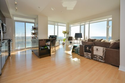 Bright Floor-To-Ceiling Wrap Around Windows With Laminate Flooring Throughout With 3 Walk-Out Balconies Facing Stunning Unobstructed Lake & Park Views