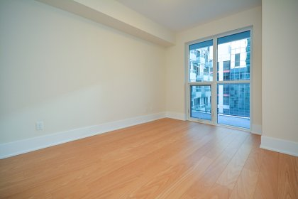 Spacious Sized Master Bedroom With A Smooth Ceiling & Plank Laminate Flooring Throughout.