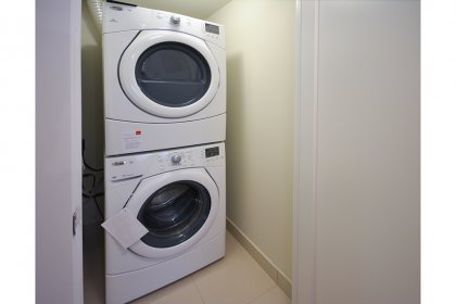 Stacked Front Loading Washer & Dryer.