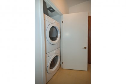 Upgraded Stacked Front Loading Washer & Dryer.