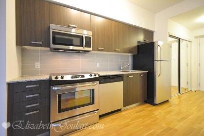 Designer Kitchen Cabinetry With Stainless Steel Appliances, Granite Counter Tops, Undermount Sink & Hardwood Flooring.