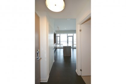 Suite Foyer With A Large Closet & Hardwood Flooring.