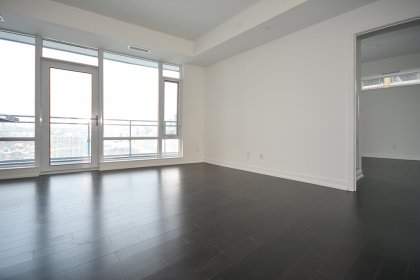 Living & Dining Areas With Hardwood Flooring Throughout.