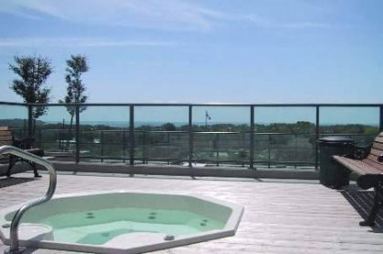 Roof Top Outdoor Terrace Facing South Lake Views With Outdoor Jacuzzi, BBQ's & Tanning Deck.