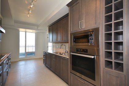 Designer Kitchen Cabinetry With Stainless Steel Appliances, Granite Counter Tops, Tile Backsplash, Undermount Sink & An Eat-In Area.