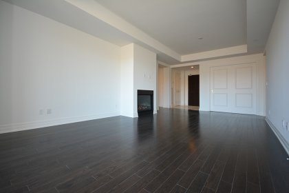 Open Concept Living & Dining Areas With A Gas Fireplace & Hardwood Flooring Overlooking The Humber River.