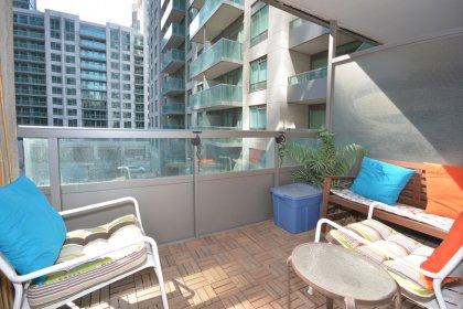 Cozy Balcony Area With Wood Tile Flooring.