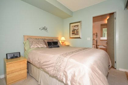Master Bedroom With A 4-Piece Ensuite & A Walk-In Closet.