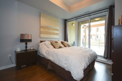 A Spacious Sized Master Bedroom With A Walk-In Closet & A Walk Out.
