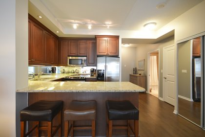 With Stainless Steel Appliances, Granite Counter Tops, An Undermount Sink, Valance Lighting & Mirrored Backsplash.