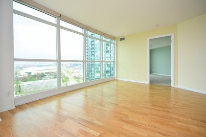 Bright Floor-To-Ceiling Windows With Hardwood Flooring Throughout The Living Areas Facing Unobstructed Lake & Park Views.