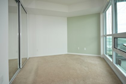 2nd Bedroom With Mirrored Closets & Unobstructed Park / Lake Views.