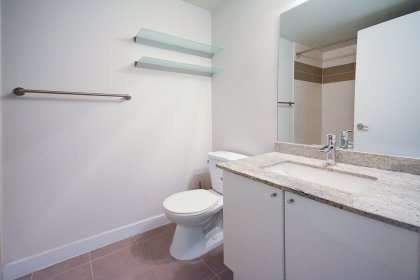 Main Bath With A 4-Piece & Granite Counter Top.
