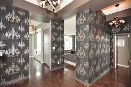 Suite Foyer With Designer Wall Paper & Hardwood Flooring.