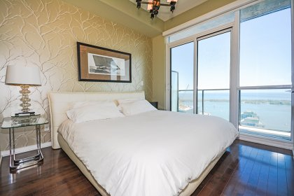 A Spacious Sized Master Bedroom With A 5-Piece Ensuite, Walk-In Closet & A Walk-Out To The Huge Entertaining Balcony Facing Lake Views.