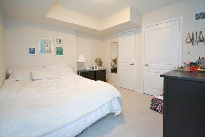 A Spacious Sized Master Bedroom With A Large Closet.