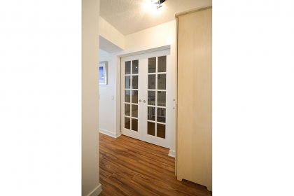 Separate Den Area With Sliding French Doors & New Laminate Flooring Throughout.