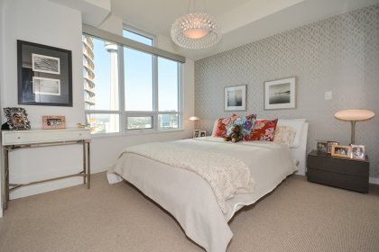 Spacious Sized 2nd Bedroom With A Designer Wall Paper, A Large Closet & Large Windows Facing C.N. Tower / City Views.