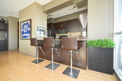 Designer Kitchen Cabinetry With Stainless Steel Appliances, Granite Counter Tops, An Undermount Sink & Breakfast Bar.