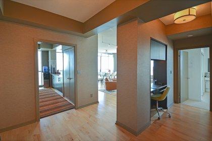 Suite Foyer With Designer Wall Paper & Hardwood Flooring.