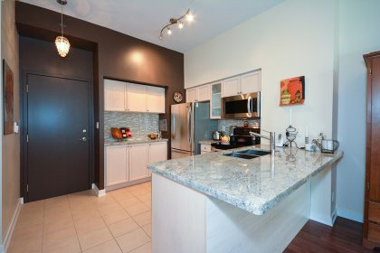 Gorgeous Updated Kitchen With Designer Kitchen Cabinetry, S/S Appliances, Extra Thick Granite Counter Tops, Glass Tile Backsplash & Breakfast Bar.