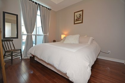 A Spacious Sized Master Bedroom With New Gleaming Hardwood Flooring & A Large Wall To Wall Closet.