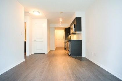 Open Concept Living & Dining Areas With Laminate Hardwood Flooring Throughout.