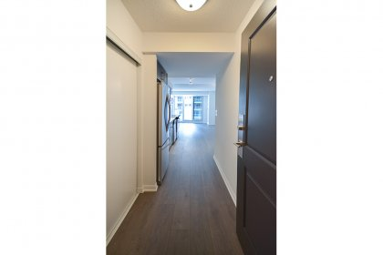 Suite Foyer With Laminate Hardwood Flooring Throughout.