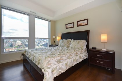 Spacious Sized Bedroom With Window Historic Fort York & C.N. Tower Views Including Hardwood Flooring Throughout.