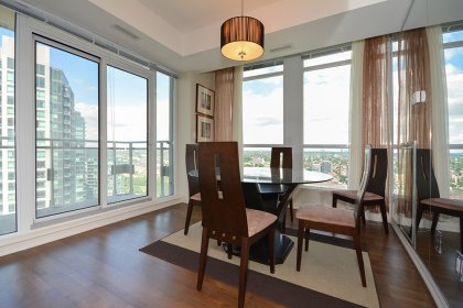 Bright Floor-To-Ceiling Windows With Hardwood Flooring Throughout Facing Balcony Lake & City Views.