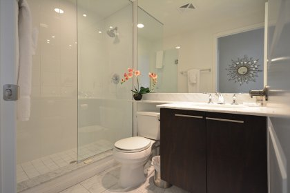 Main Bath With A 3-Piece Including Full Sized Mirror & Frameless Glass Stand-Up Shower.