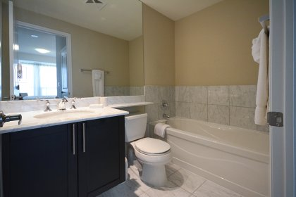 Master Ensuite With A 4-Piece  Including Full Sized Mirror, Separate Frameless Glass Stand-Up Shower & A Soaker Tub.