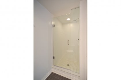 Main Bath With A 3-Piece & Frameless Stand-Up Shower.