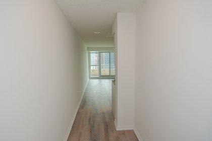 Suite Foyer With Laminate Hardwood Flooring Throughout.