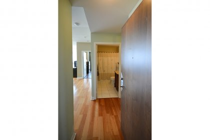 Suite Foyer With Laminate Flooring & Mirrored Closet.