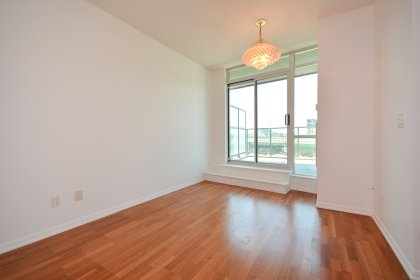 Open Concept Living / Dining Areas With Bright Large Windows & Laminate Flooring.