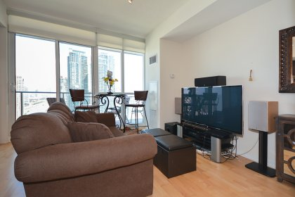 Bright 9' Floor-To-Ceiling Windows With Hardwood Flooring Facing Unobstructed City Views.