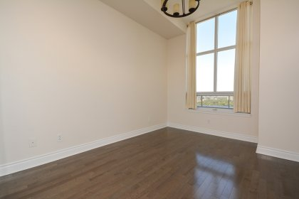 2nd Bedroom With Gleaming Hardwood Flooring & Mirrored Closets With Custom Organizers.