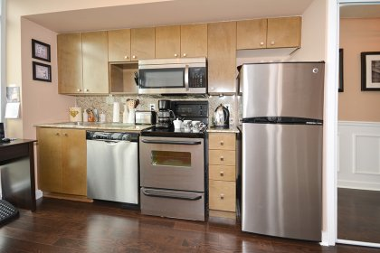 Designer Kitchen Cabinetry With Newer Upgraded Stainless Steel Appliances, Granite Counter Tops & Backsplash.