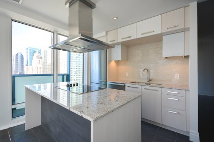 Designer Kitchen Cabinetry With Stainless Steel Appliances, Granite Counter Tops, Undermounk Sink, Valance Lighting & A Breakfast Bar.
