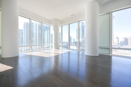Bright Floor-To-Ceiling Wrap Around Windows With Gleaming Hardwood Flooring Throughout Facing Stunning Unobstructed C.N. Tower & City Views.