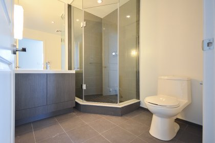 Main Bath With A 3-Piece & Glass Stand-Up Shower.