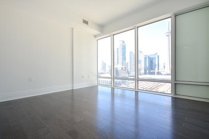 2nd Bedroom With Gleaming Hardwood Flooring Facing Unobstructed C.N. Tower & City Views